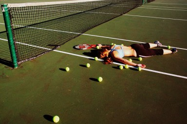 tennis player falling on court